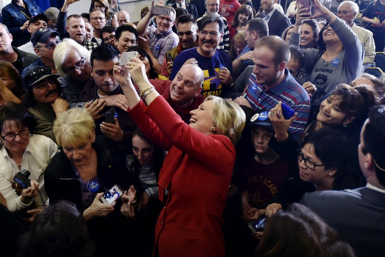 Democratic presidential candidate Hillary Clinton takes a selfie with supporters after speaking at a campaign rally in Las Vegas, Nev., Feb. 14, 2016. (Photo by David Becker/Reuters)