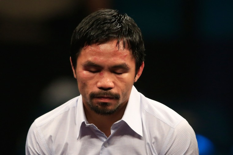 Manny Pacquiao answers questions during the post-fight news conference on May 2, 2015 at MGM Grand Garden Arena in Las Vegas, Nev. (Photo by Jamie Squire/Getty)