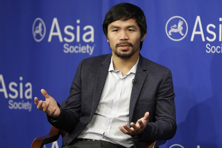 In this Oct. 12, 2015, file photo, Manny Pacquiao takes questions at the Asia Society in New York. (Photo by Seth Wenig/AP)