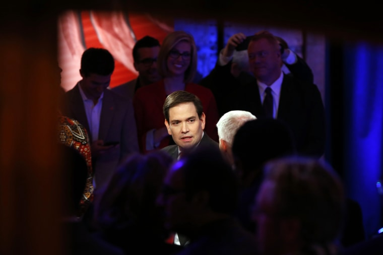 Republican presidential candidate, Sen. Marco Rubio, R-Fla., talks with Anderson Cooper during a commercial break at a CNN town hall event, Feb. 16, 2016, in Greenville, S.C. (Photo by Paul Sancya/AP)