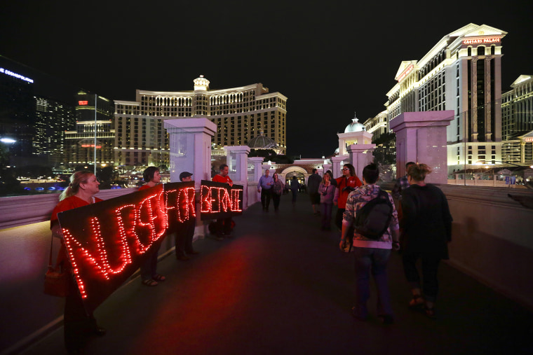 Members of the National Nurses United union hold LED signs to show their support for Democratic presidential candidate Sen. Bernie Sanders, I-Vt., Feb. 17, 2016, in Las Vegas. (Photo by Jae C. Hong/AP)