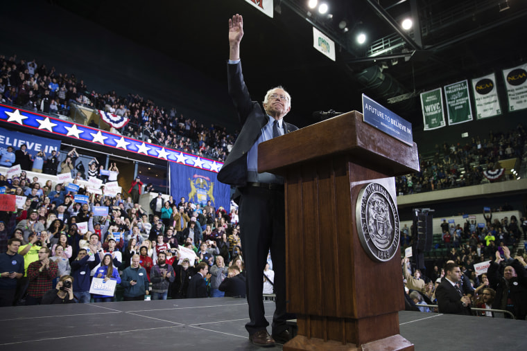 Democratic presidential candidate Sen. Bernie Sanders, I-Vt., waves during a rally at Eastern Michigan University, Feb. 15, 2016, in Ypsilanti, Mich. (Photo by Evan Vucci/AP)
