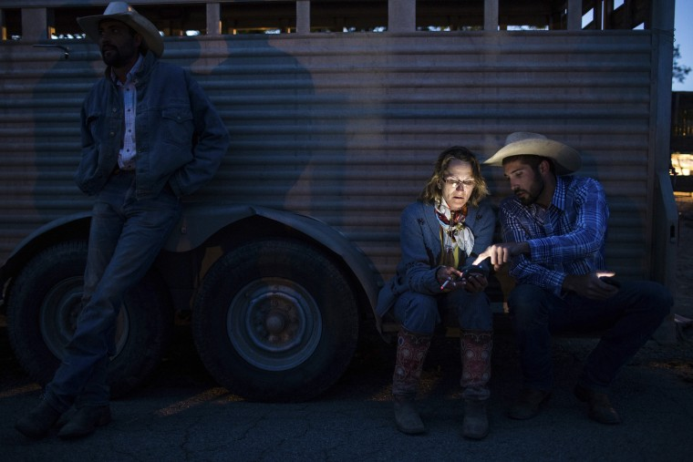 Citizens from Elko relax after a long day of riding from their home town to the State Capitol in Carson City to deliver a petition on land use to their Governor, May 29, 2014. (Photo by Max Whittaker/Reuters)