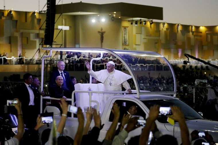 Pope Francis waves from his popemobile as he leaves the fairgrounds in Ciudad Juarez, Mexico, Feb. 17, 2016, where he celebrated an outdoor Mass. (Photo by Gregory Bull/Reuters)
