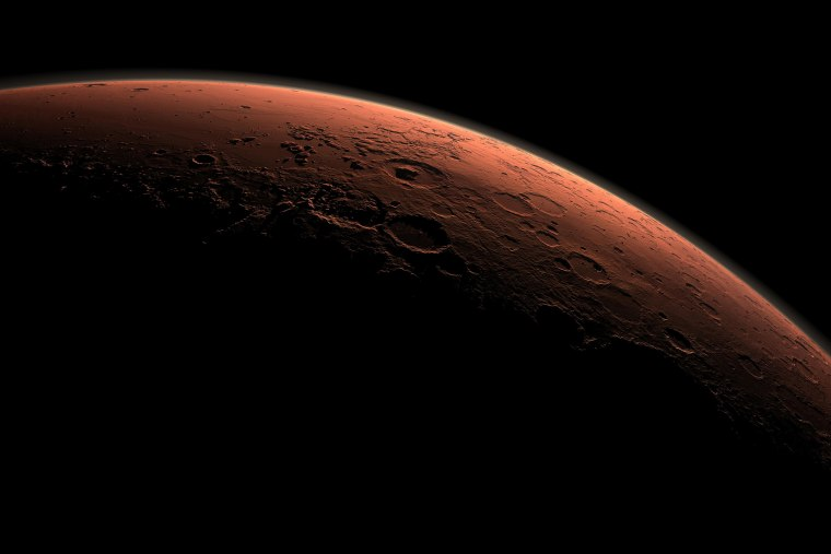This computer-generated view depicts part of Mars at the boundary between darkness and daylight, with an area including Gale Crater beginning to catch morning light, in this handout image provided by NASA. (Photo by NASA/JPL-Caltech/Reuters)