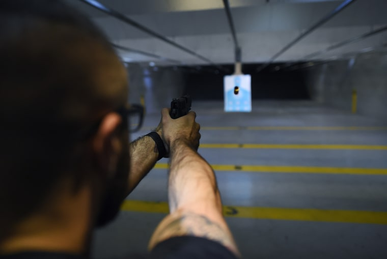 A man fires a handgun at a shooting range in New Jersey on Dec. 9, 2015. (Photo by Jewel Samad/AFP/Getty)