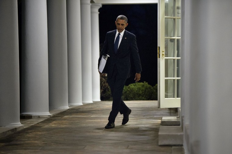 President Obama walks from the West Wing to the residence of the White House with a binder of potential Supreme Court nominees in Washington, Feb. 19, 2016. (Photo by Brendan Smialowski/AFP/Getty)