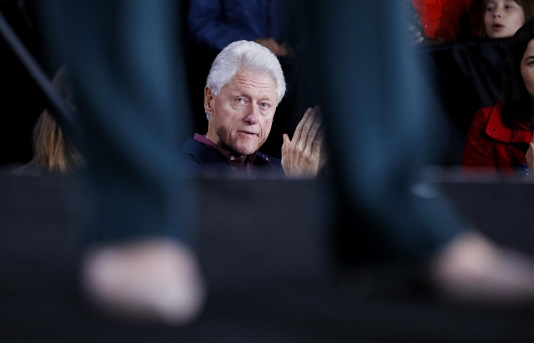 Former President Bill Clinton listens to Democratic presidential candidate Hillary Clinton speak during a rally, Feb. 19, 2016, in Las Vegas. (Photo by John Locher/AP)