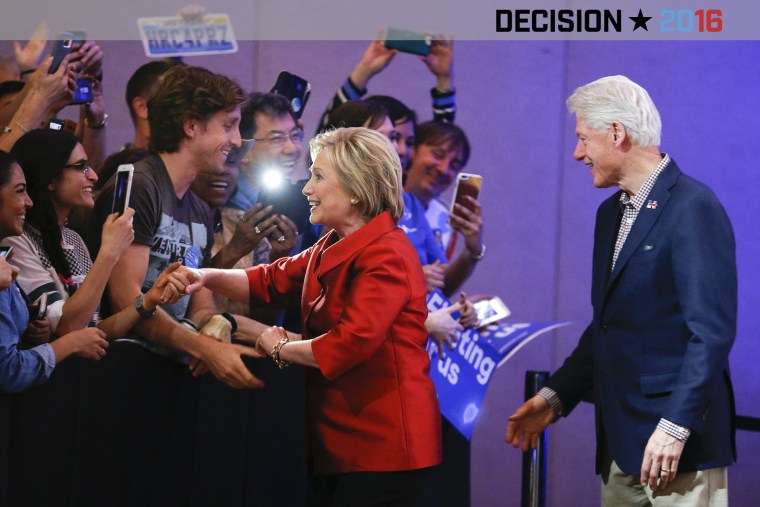Democratic presidential candidate Hillary Clinton greets supporters with her husband and former President Bill Clinton at a Nevada Democratic caucus rally on Feb. 20, 2016, in Las Vegas, Nev. (Photo by John Locher/AP)