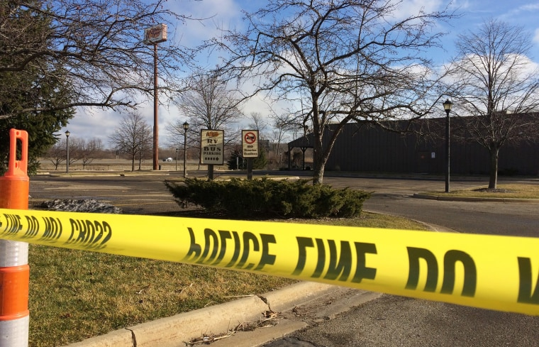 Police tape surrounds the area of a random shooting on Feb. 21, 2016, in Kalamazoo, Mich. Jason Dalton of Kalamazoo County was arrested early Sunday in downtown Kalamazoo after several victims were shot at random. (Photo by Jeff Karoub/AP)