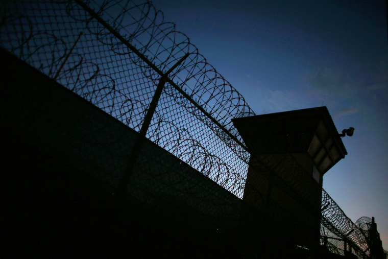 Razor wire is seen near the guard tower at the entrance to Camp V and VI at the U.S. military prison for 'enemy combatants' on June 26, 2013 in Guantanamo Bay, Cuba. (Photo by Joe Raedle/Getty)