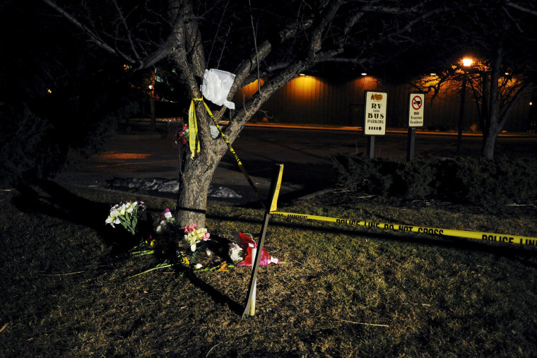 Flowers are placed at a makeshift memorial near a Cracker Barrel restaurant, one of the sites of a series of random shootings that killed six people in Kalamazoo County, Mich., on Feb. 21, 2016. (Photo by Mark Kauzlarich/Reuters)