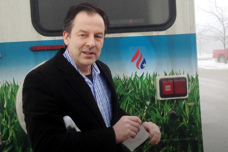 Rick Tyler, communications director for Sen. Ted Cruz, R-Texas presidential campaign, speaks speaks after affixing a Cruz sticker on an RV of a group that is openly critical of Cruz, Jan. 7, 2015, in Storm Lake, Iowa. (Photo by Scott Bauer/AP)