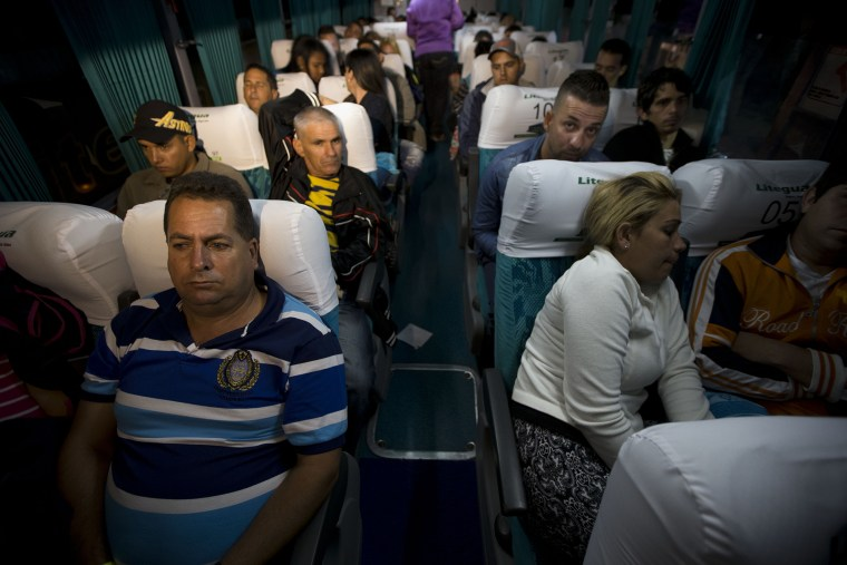 Cuban migrants wait on a bus in Ciudad Pedro De Alvarado, Guatemala, at the border with El Salvador, Jan. 13, 2016, as they continue on their journey to the United States. (Photo by Moises Castillo/AP)
