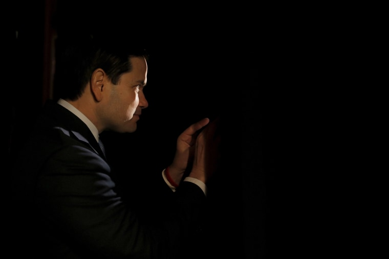 Republican presidential candidate Marco Rubio peeks through curtains before being introduced during a campaign event in Reno, Nev., Feb. 22, 2016. (Photo by Chris Keane/Reuters)