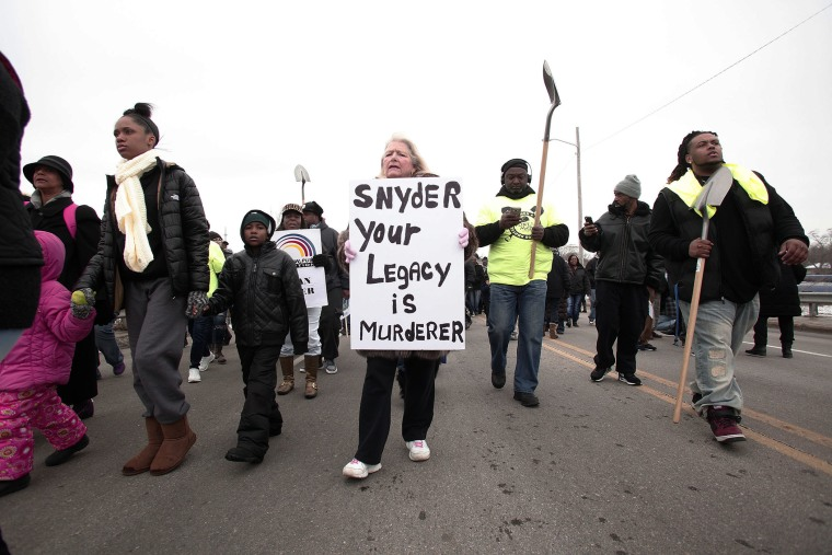 People participate in a national mile-long march to highlight the push for clean water in Flint, Feb. 19, 2016 in Flint, Mich. (Photo by Bill Pugliano/Getty)