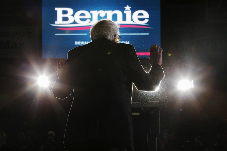 Democratic presidential candidate and Senator Bernie Sanders is silhouetted as he speaks at a campaign rally at UMass Amherst in Amherst, Mass., Feb. 22, 2016. (Photo by Brian Snyder/Reuters)