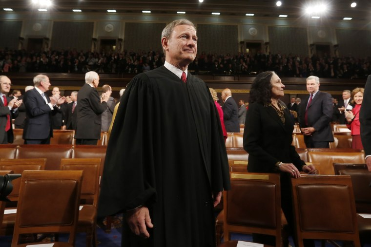Supreme Court Chief Justice John Roberts arrives prior to President Barack Obama's State of the Union speech on Capitol Hill on Jan. 28, 2014 in Washington, DC. (Photo by Larry Downing/Pool/Getty)