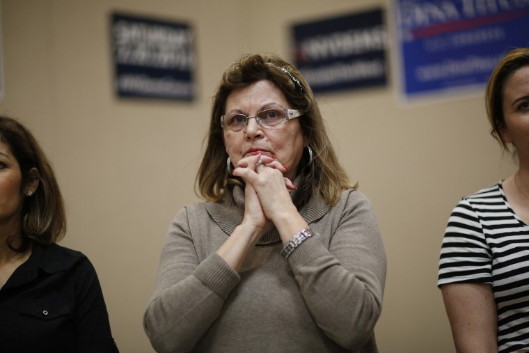 Teresa Parraga listens during a Latino get-out-the-caucus event, Feb. 16, 2016, in Las Vegas. (Photo by John Locher/AP)