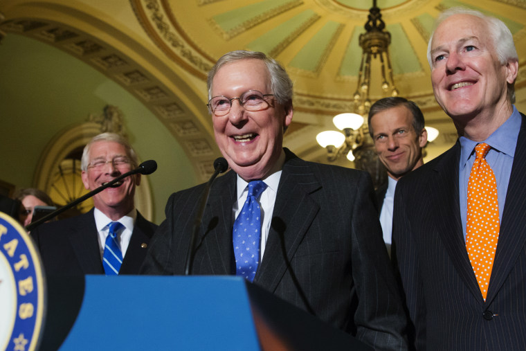 Senate Majority Leader Mitch McConnell, R-Ky., smiles as he speaks with reporters following a closed-door policy meeting on Capitol Hill in Washington, Feb. 23, 2016. (Photo by J. Scott Applewhite/AP)