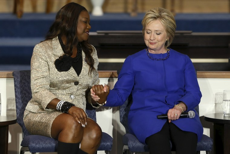 Sybrina Fulton (L), mother of shooting victim Trayvon Martin, endorses U.S. Democratic presidential candidate Hillary Clinton during a town hall meeting at Central Baptist Church in Columbia, S.C., on Feb. 23, 2016. (Photo by Jonathan Ernst/Reuters)