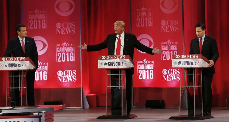 Republican presidential candidate, businessman Donald Trump speaks about Republican presidential candidate, Sen. Ted Cruz, R-Texas, left, as Republican...