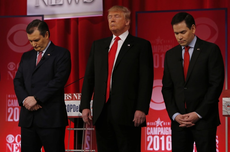 Republican presidential candidates Sen. Ted Cruz, Donald Trump and Sen. Marco Rubio pause in honor of Supreme Court Associate Justice Antonin Scalia before the start of the Republican presidential debate, Feb. 13, 2016. (Photo by Jonathan Ernst/Reuters)