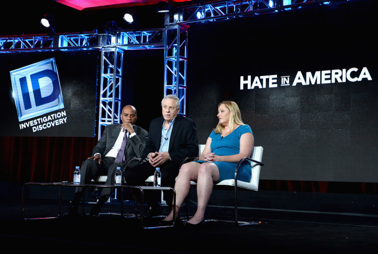 """Hate In America"" Host Tony Harris, Founder, Southern Poverty Law Center Morris Dee, and Intelligence Project Director Heidi Beirich speak during the Discovery Communications TCA Winter 2016, Jan. 7, 2016, Pasadena, Calif. (Photo by Amanda Edwards/Getty)"
