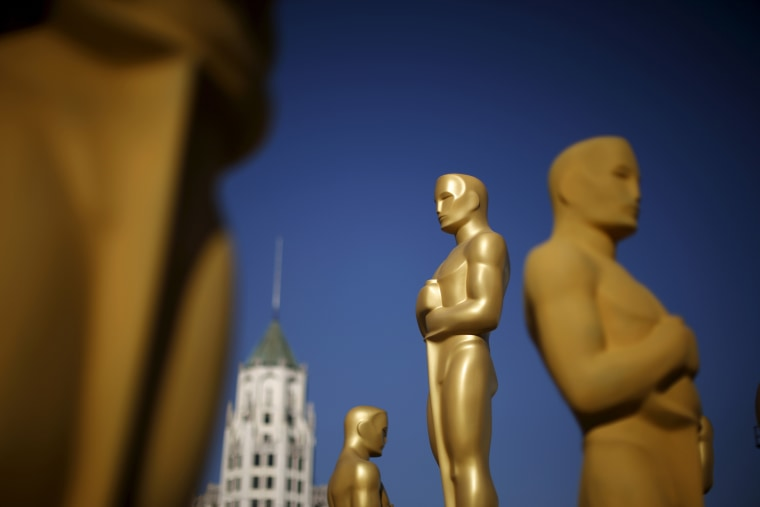 Oscar statues are painted outside the entrance to the Dolby Theatre as preparations continue for the 88th Academy Awards in Hollywood, Calif., Feb. 25, 2016. (Photo by Lucy Nicholson/Reuters)