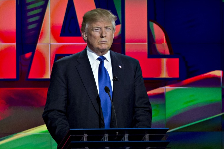 Donald Trump stands behind his podium during the Republican presidential primary candidate debate in Houston, Texas, Feb. 25, 2016. (Photo by Andrew Harrer/Bloomberg/Getty)