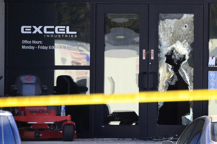 Shattered glass and bullet holes are seen at the front door of Excel Industries in Hesston, Kan., Feb. 26, 2016. Harvey County Sheriff T. Walton identified the gunman as Cedric Ford. (Photo by Orlin Wagner/AP)