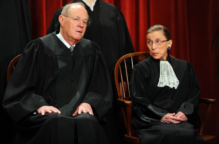 U.S. Supreme Court Associate Justice Anthony M. Kennedy and Associate Justice Ruth Bader Ginsburg participate in the courts official photo session, Oct. 8, 2010. (Photo by Tim Sloan/AFP/Getty)