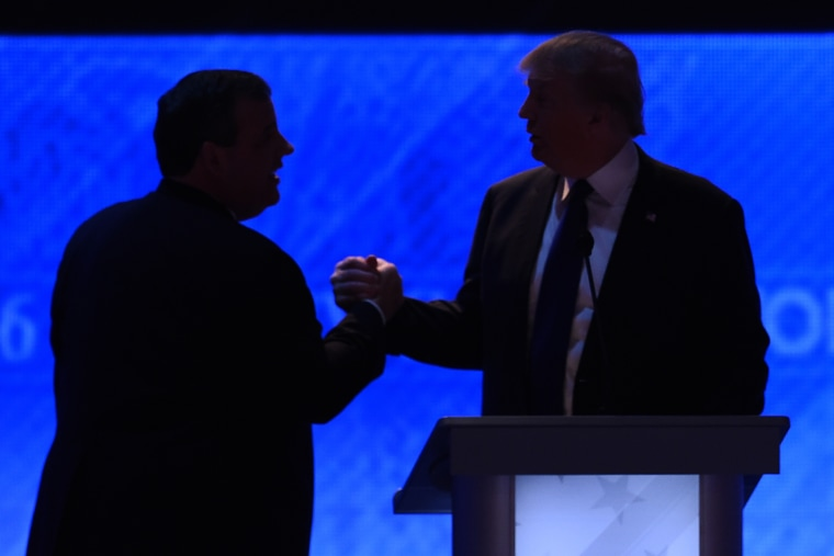 Republican presidential candidates Donald Trump (R) and Chris Christie (L) shake hands during a break in the Republican Presidential Candidates Debate on Feb. 6, 2016 in Manchester, N.H. (Photo by Jewel Samad/AFP/Getty)