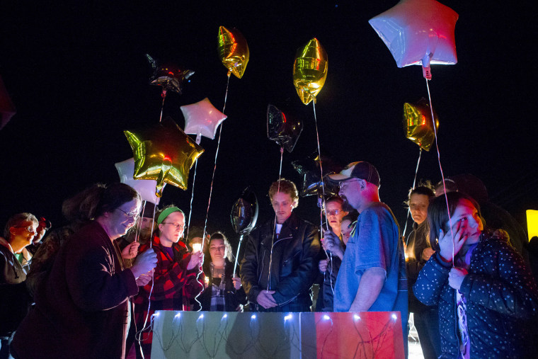 Family and friends hold a candle light vigil on Hesston Road for shooting victim Brian Sadowsky outside the Excel Industries plant on Feb. 26, 2015 in Kansas. (Photo by Kyle Rivas/Getty)