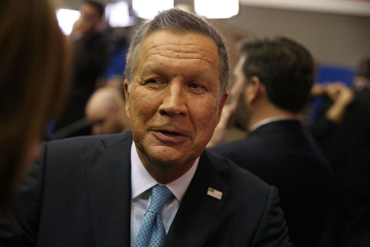 Republican presidential candidate Ohio Gov. John Kasich speaks to the media in the spin room at the Republican National Committee Presidential Primary Debate, Feb. 25, 2016 in Houston, Texas. (Photo by Joe Raedle/Getty)