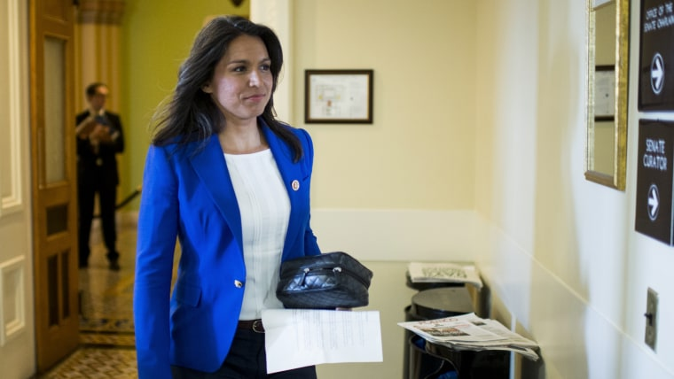 Rep. Tulsi Gabbard, D-Hawaii, arrives to participate in the news conference on March 26, 2014, in Washington, D.C. (Photo By Bill Clark/CQ Roll Call/Getty)