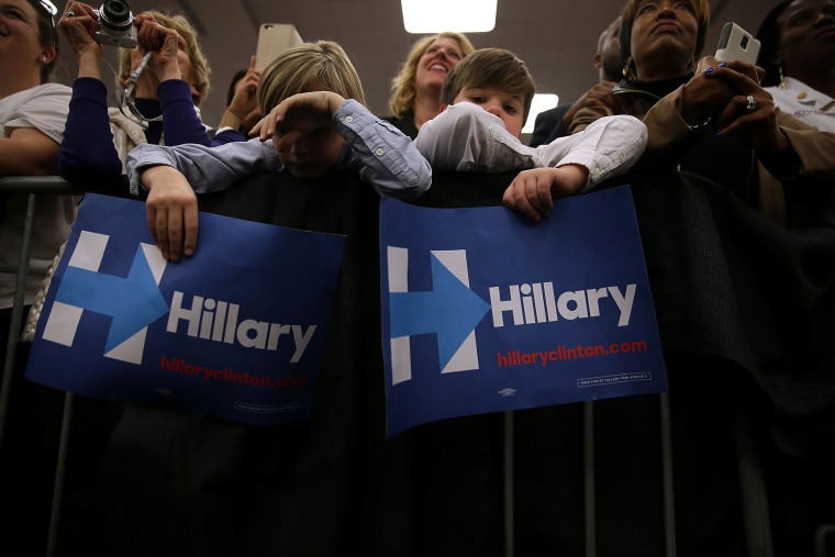 """Young supporters hold signs as Hillary Clinton speaks during a """"Get Out The Vote"""" event at Meharry Medical College on Feb. 28, 2016 in Nashville, Tenn. (Photo by Justin Sullivan/Getty)"""