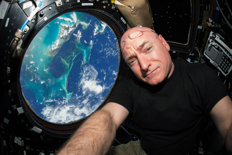 "This July 12, 2015 photo made available by NASA, astronaut Scott Kelly poses for a selfie photo in the ""Cupola"" of the International Space Station. (Photo by Scott Kelly/NASA/AP)"