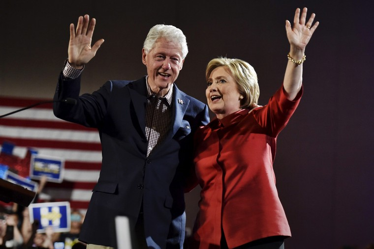 Democratic presidential candidate Hillary Clinton and her husband former President Bill Clinton wave to supporters in Las Vegas, Nev., Feb. 20, 2016. (Photo by David Becker/Reuters)
