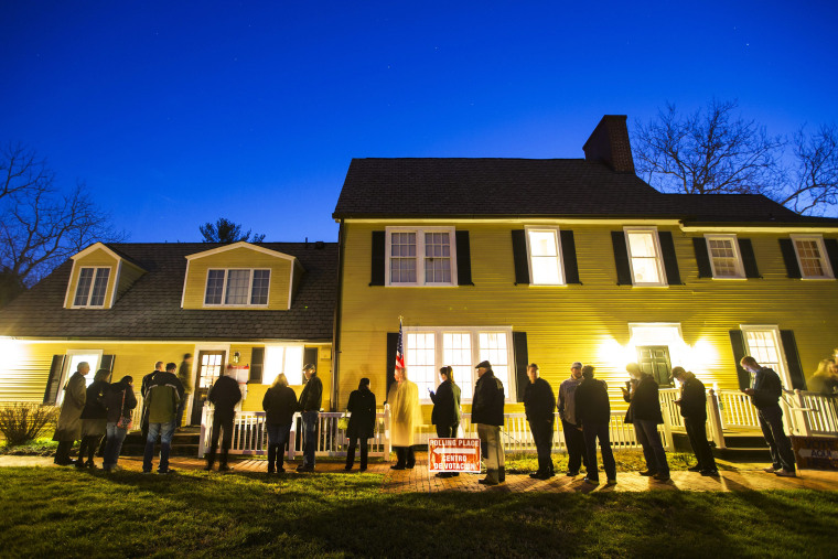 Virginia residents wait in line in the pre-dawn hours to vote in the Virginia primary at a historic property called the Hunter House at Nottoway Park in Vienna, Va., on March 1, 2016. (Photo by Jim Lo Scalzo/EPA)