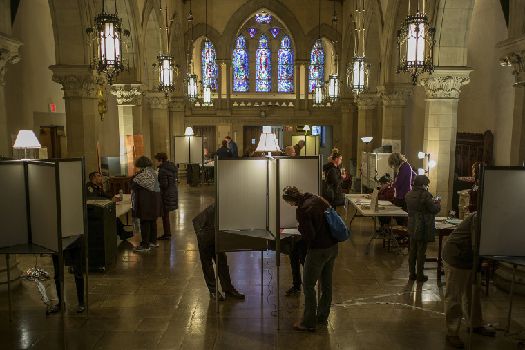 Voters cast their ballots at the Old South Church polling place in Boston, Mass., on March 1, 2016. (Photo by CJ Gunther/EPA)