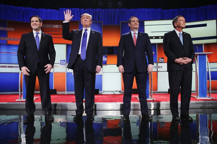 Republican presidential candidates pose before a debate sponsored by Fox News on March 3, 2016 in Detroit, Mich. (Photo by Chip Somodevilla/Getty)