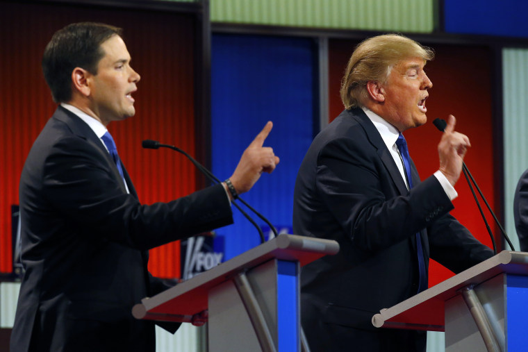 Republican presidential candidates Sen. Marco Rubio and businessman Donald Trump argue during a Republican presidential primary debate at Fox Theatre on March 3, 2016, in Detroit, Mich. (Paul Sancya/AP)