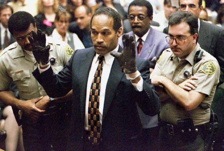 O.J. Simpson holds up his hands to the jury in this June 15, 1995 file photo. (Photo by Sam Mircovich/Reuters)