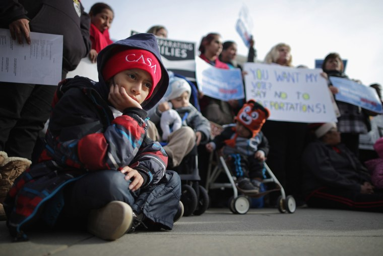 About fifty pro-immigration reform demonstrators gathered for a rally outside the United States Supreme Court Jan. 15, 2016 in Washington, DC. (Photo by Chip Somodevilla/Getty)