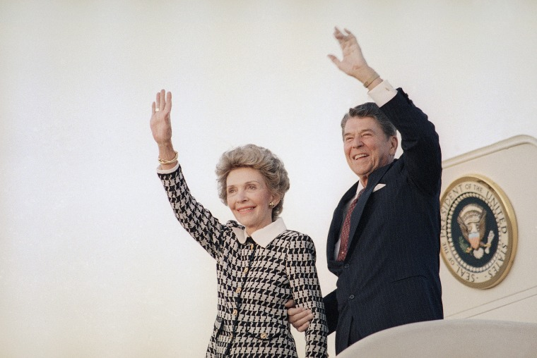 President Ronald Reagan and Mrs. Reagan wave from Air Force One at Andrews Air Force Base in evening on Sep. 8, 1986 as they return to Washington. (Photo by J. Scott Applewhite/AP)