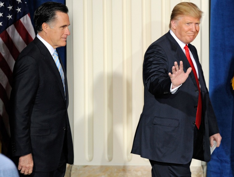 Then-Republican presidential candidate Mitt Romney and Donald Trump arrive at a news conference held by Trump to endorse Romney for president at the Trump International Hotel & Tower Las Vegas, Feb. 2, 2012. (Photo by Ethan Miller/Getty)