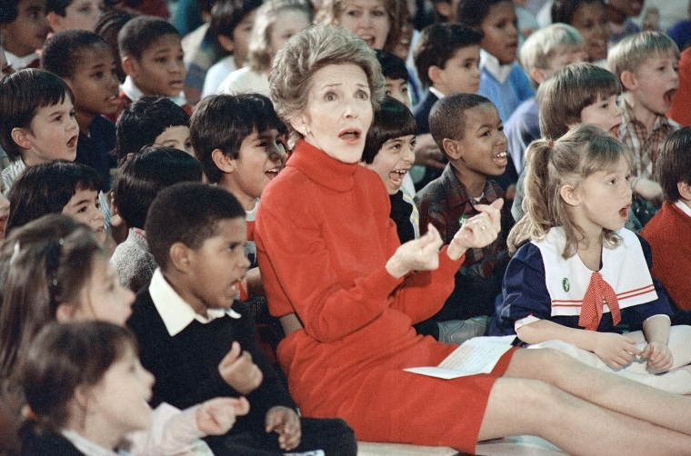 First Lady Nancy Reagan watches an anti-drug musical entitled Just Say No performed by teenage students from the Chantilly, Va., High School at the Cameron Elementary School, Feb. 26, 1987. (Photo by Scott Stewart/AP)