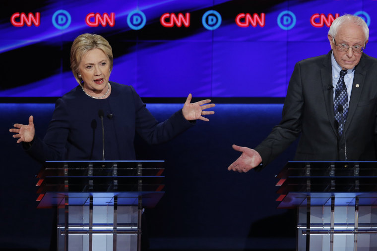 Democratic presidential candidate Hillary Clinton battles Bernie Sanders during the Democratic presidential candidates' debate in Flint, Mich., March 6, 2016. (Photo by Jim Young/Reuters)