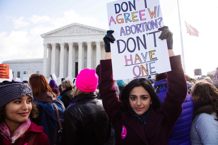 Demonstrators assembled in front of the Supreme Court steps in Washington D.C. on March 2, 2016 as the Court heard oral arguments in the Whole Woman's Health v. Hellerstedt case. (Photo by Jeff Malet/Newscom/ZUMA)